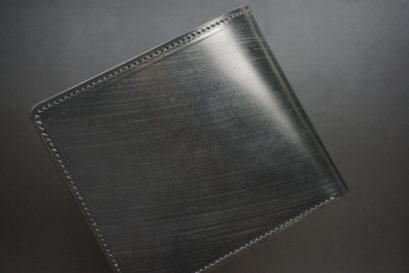 クレイトン社のブライドルレザーのブラックカラーの二つ折り財布(小銭入れ付き)の画像1