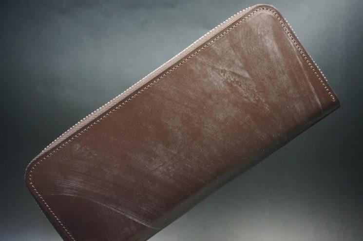メトロポリタン社のブライドルレザーのダークブラウンカラーのラウンドファスナー長財布の画像1