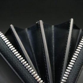 セドウィック社製ブライドルレザーのブラックカラーのラウンドファスナー長財布のコバ