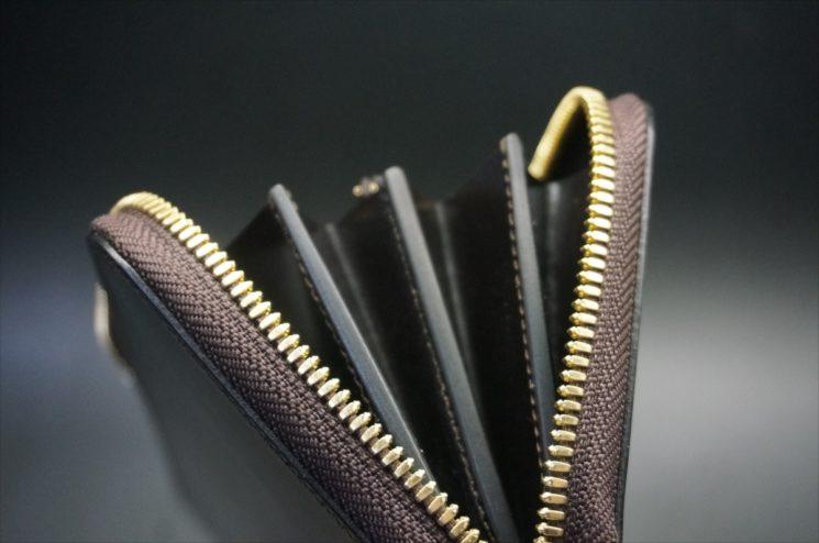 セドウィック社製ブライドルレザーのチョコカラーのラウンドファスナー長財布のコバ