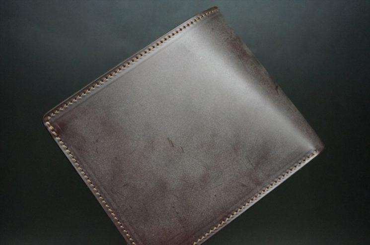 新喜皮革社製蝋引き顔料仕上げコードバンのダークブラウン色の二つ折り財布(ゴールド色)-1-1